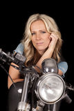 Woman motorcycle on black look hand cheek royalty free stock photography