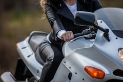 Woman on motorcycle. Woman in black sitting on motorcycle Royalty Free Stock Photography