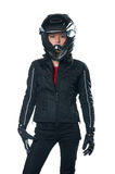 Woman in motorcycle clothing. Young woman posing in black motorcycle clothing and helmet. Isolated on white Stock Photo