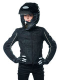Woman in motorcycle clothing. Young woman posing in black motorcycle clothing and helmet. Isolated on white stock photography