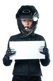 Woman in motorcycle clothing holding a white board Royalty Free Stock Image