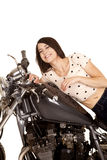 Woman on a motorcycle gas tank smiling Stock Photo