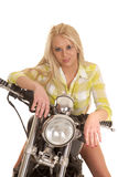 Woman motorcycle green plaid lean forward Stock Images
