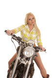 Woman motorcycle green plaid sit facing Royalty Free Stock Photography