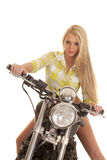 Woman motorcycle green plaid sit look smile Royalty Free Stock Image