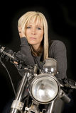 Woman on motorcycle hand hair serious stock photos