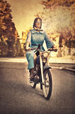 Woman on motorcycle. Woman on a motorcycle in jacket Royalty Free Stock Photo