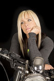 Woman on motorcycle look side black back Stock Photography