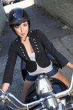 Happy Woman riding v-twin street motorcycle Stock Images