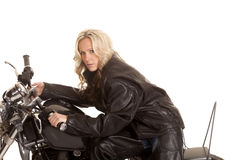 Woman on a motorcycle serious looking close Royalty Free Stock Photography