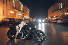 Woman on a motorcycle Stock Photos