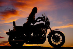 Woman motorcycle silhouette riding Royalty Free Stock Images