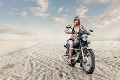 Woman on motorcycle Royalty Free Stock Images