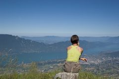 Woman in mountain. Sporting woman looking at a lake Stock Photography