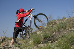 The woman on a mountain bicycle. The young woman on a mountain bicycle Royalty Free Stock Photo