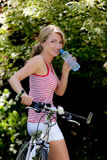Woman with mountain bike Royalty Free Stock Image