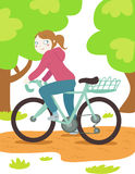 Woman on mountain bike. A beautiful woman on bicycle in the nature Stock Photos
