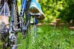 Woman on mountain bike closeup Royalty Free Stock Photos