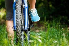 Woman on mountain bike closeup Stock Images