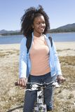 Woman With Mountain Bike By The Lake Stock Images