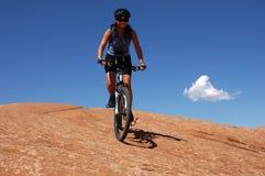Woman mountain biking. On slick rock in Moab Stock Photo