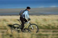 Woman mountain biking. Blur/action shot of female mountain biker Stock Photo