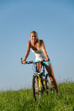 Woman mountain biking Royalty Free Stock Image