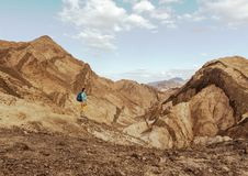 Woman Hiker with backpack enjoy view in desert Royalty Free Stock Image