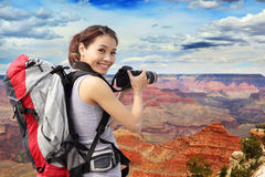 Woman mountain hiker taking pictures Royalty Free Stock Image