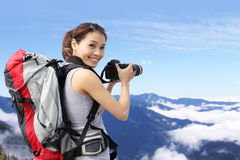 Woman mountain hiker taking pictures Royalty Free Stock Photo