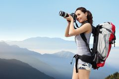 Woman mountain hiker taking pictures Royalty Free Stock Images