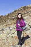 Woman on mountain hiking. Young caucasian woman hiking on Swiss alps in autumn Royalty Free Stock Photography