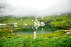 Woman on the mountain lake Royalty Free Stock Images