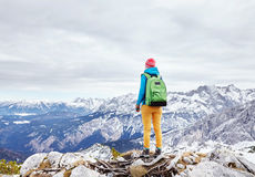 Woman on mountain peak Royalty Free Stock Image