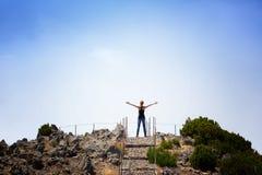 Woman on the mountain peak Stock Image