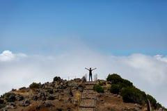 Woman on the mountain peak Royalty Free Stock Photos