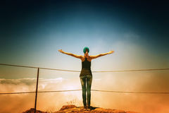 Woman on the mountain peak Royalty Free Stock Images