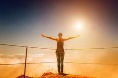 Woman on the mountain peak Royalty Free Stock Photography