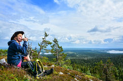 Woman on mountain. Woman resting and drinking on mountain hiking trail Royalty Free Stock Photo