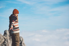 Woman on mountain summit sky clouds on background Stock Images