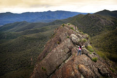 Woman on Mountain Top. Single young woman looks out with determination on a mountain top Stock Images