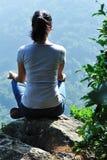 Woman mountain top yoga  Stock Photos