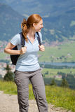 Woman on a Mountain Trail in Summer Stock Images