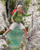Woman on mountain trek Royalty Free Stock Photos