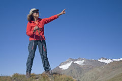 Woman in the mountains Stock Images