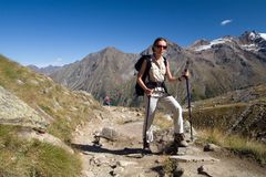 Woman in the mountains. (italian Alps, Gran Paradiso royalty free stock photos