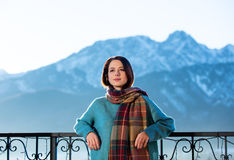 Woman with mountains on background Royalty Free Stock Photography
