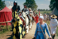 Woman and mounted knights. Medieval woman and mounted knights cavalcade - 600th anniversary Battle of Grunwald 1410. 6000 reenactors,2200 knights,near 200 royalty free stock images