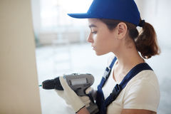 Woman Mounting Walls on Construction Site Royalty Free Stock Images