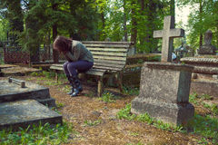 Woman mourns in the cemetery Royalty Free Stock Photography